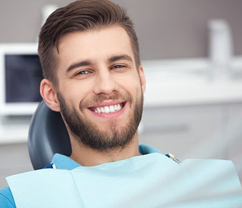Happy young male patient