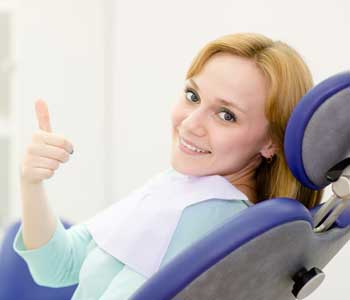 Happy female patient with thumbs up