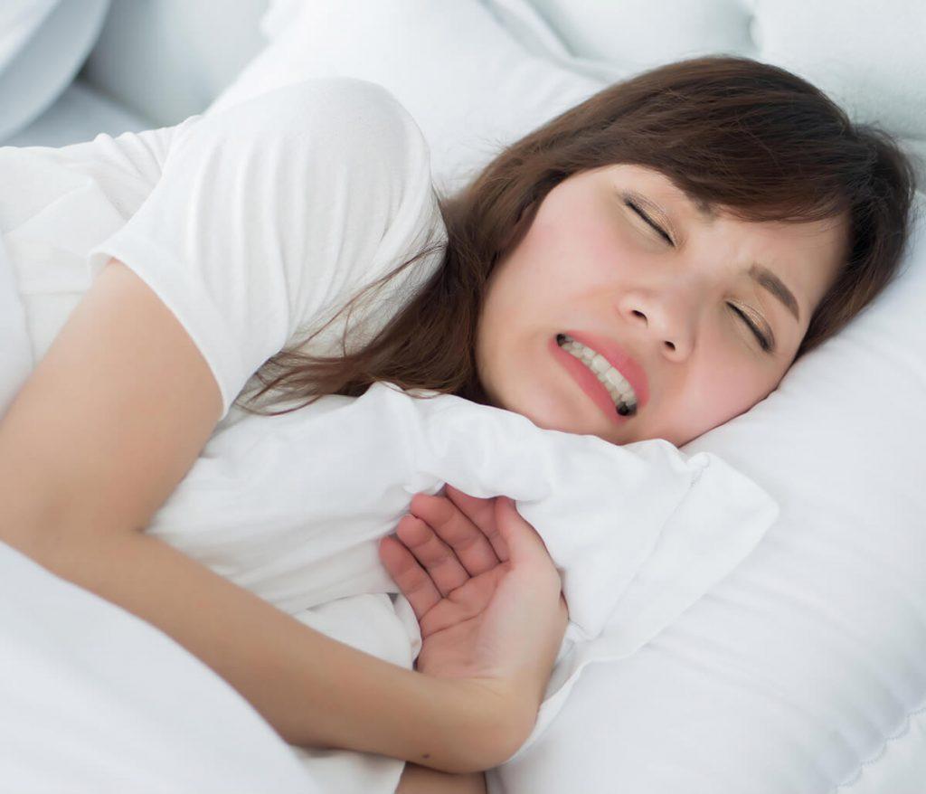 Young woman having trouble sleeping