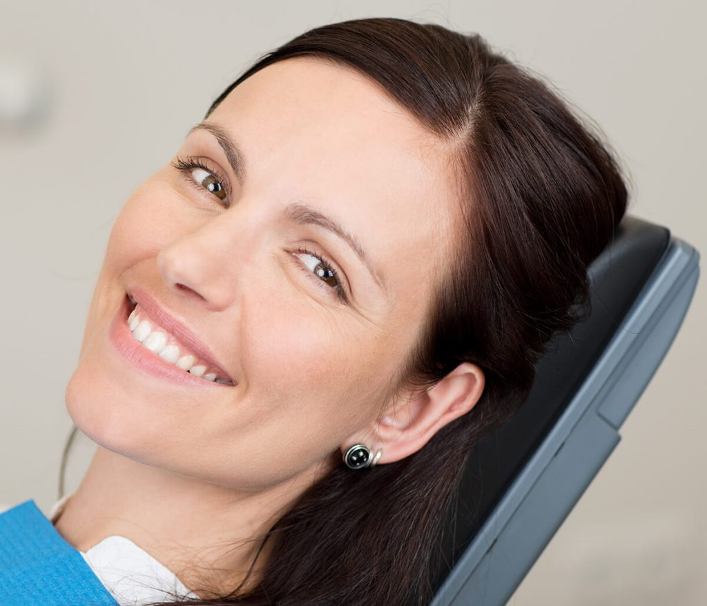 Middle-aged female patient smiling